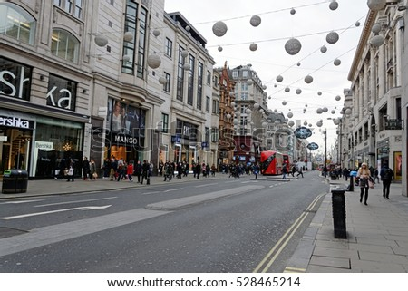 London,England - November 23, 2016:Oxford Street-The full length of the busiest shopping area in central London is decorated with 1778 glowing white and golden orbs.