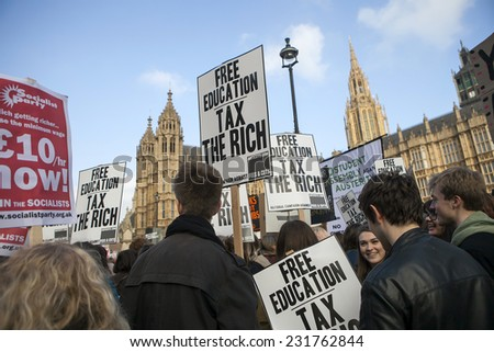LONDON, ENGLAND - NOVEMBER 19: Students take part in a protest march against fees and cuts in the education system on November 19, 2014 in London, England. - stock photo