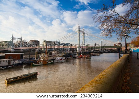 London,England-November 18,2011:The Albert Bridge.It is a road bridge over the River Thames in West London, connecting Chelsea on the north bank to Battersea on the south bank. - stock photo