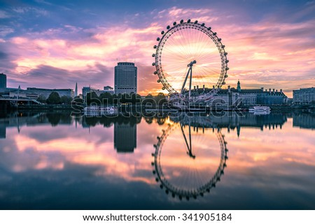 LONDON, ENGLAND - NOVEMBER 11 2015 : The London Eye on the South Bank of the River Thames at sunrise in London, England. - stock photo