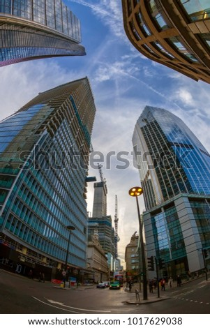 LONDON, ENGLAND - NOVEMBER 27, 2017: Wide angle shot of skyscrapers in Central London and buildings in construction. Sunset time.