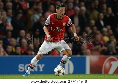 LONDON, ENGLAND - Oct 01 2013: Arsenal's midfielder Mesut Ozil from Germany   during the UEFA Champions League match between Arsenal and Napoli. - stock photo