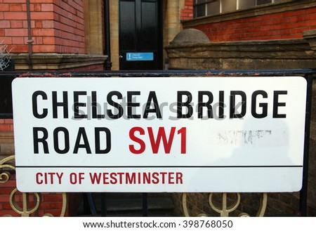 LONDON, ENGLAND - OCT, 11: The chelsea bridge road name plate put on the metal fence scene on October 11, 2015 in London England.