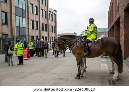 London, England - October 15: Police on horses near Millennium Bridge in London, England on October 15, 2014.