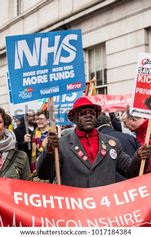 London, England. 3rd February 2018. EDITORIAL - Black man holding a placard at the NHS In Crisis demonstration through central London, in protest of underfunding & privatisation of the NHS.