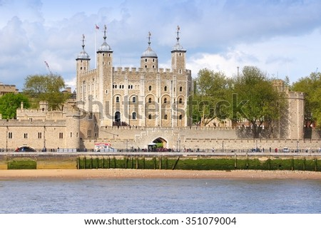 London, England - river Thames view with Tower of London. UNESCO World Heritage Site. - stock photo