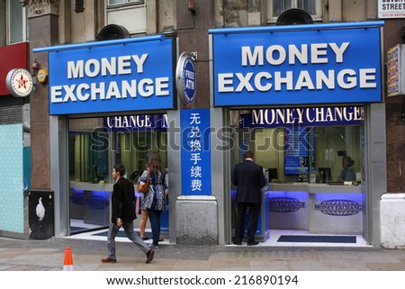 London England Sept   A Man Passes By A Money Exchange