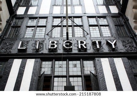 London, England - Sept 4th, 2014: The sign above the entrance to the Liberty department store in Regent Street, London. Opened in 1875 the store is identified with luxury goods and classic designs. - stock photo