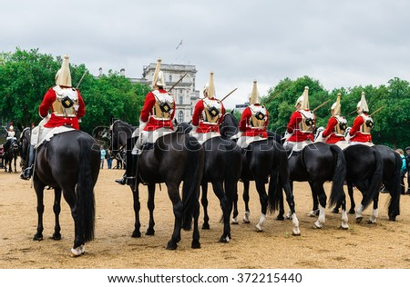 London, England - September 15: British Royal guards riding on horse and perform the Changing of the Guard in London, UK - stock photo