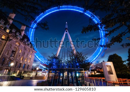 LONDON, ENGLAND - SEPTEMBER 26: London Eye on September 26th 2012 in London. The 135 meter landmark is a giant Ferris wheel situated on the banks of the River Thames in London, England. - stock photo