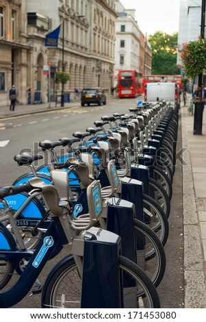 LONDON, ENGLAND - SEPTEMBER 27, 2013: Many bicycles on Cycle Hire parking lot. During the 2012 Olympic Games, a record of over than 47 thousand cycle hires were made in a single day.  - stock photo