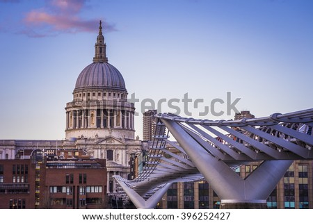 London, England - St.Paul's Cathedral and Millennium Bridge at sunset