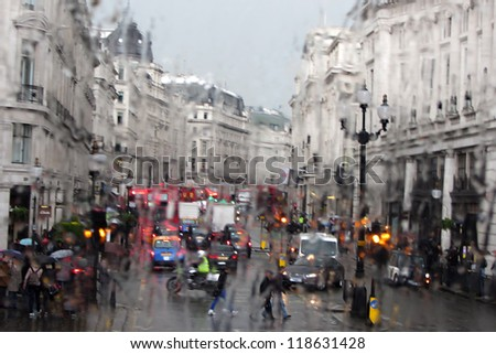 London, England - street scene in the rain - stock photo