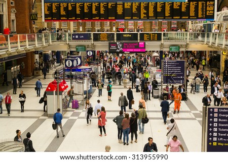 LONDON - ENGLAND 18TH AUGUST 2015 - Commuters rush to their trains at the very busy London Liverpool Street Station in August of 2015 - stock photo