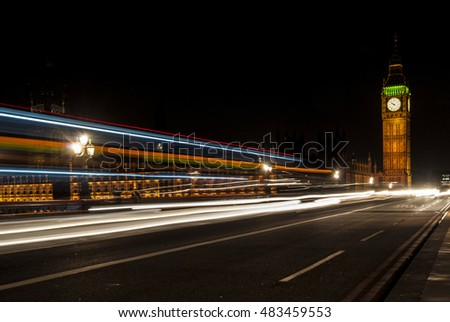 LONDON,ENGLAND,U.K. - APRIL 11, 2013: View of Big Ben at night, illuminated, with light lines of cars