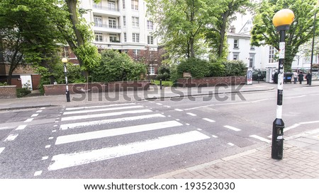 LONDON, ENGLAND, UK: Abbey Road Crossing outside Abbey Road studios where the homonymous album was recorded in 1969 - stock photo