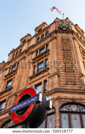 London, England, UK - August 3, 2014: View of the London Tube sign near the Harrods upmarket department store on Brompton Road in Knightsbridge, London.