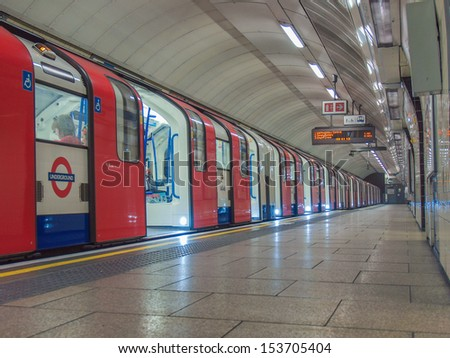 LONDON, ENGLAND, UK - JUNE 19: Train departing from an underground Tube Station on June 19, 2011 in London, England, UK - stock photo