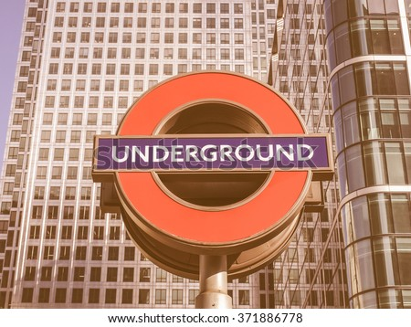 LONDON, ENGLAND, UK - MARCH 05, 2009: Iconic London Underground sign known as the Roundel designed by Edward Johnston in 1917 vintage