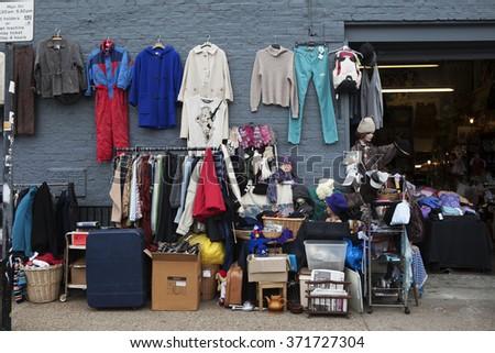 LONDON, ENGLAND, UK - MAY 4, 2014: traditional flea market at Brick Lane. Brick Lane flea market operates every Sunday. - stock photo