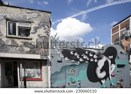 LONDON, ENGLAND, UK - MAY 4, 2014 - urban graffiti near Brick lane East London. The work is drawing portrait of angel by unknown artist. Urban art in Shoreditch attracts tourists from all over world - stock photo