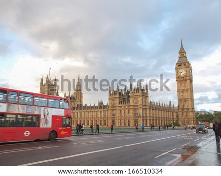 LONDON, ENGLAND, UK - OCTOBER 23: People crossing the world famous Westminster Bridge in front of the Houses of Parliament on October 23, 2013 in London, England, UK