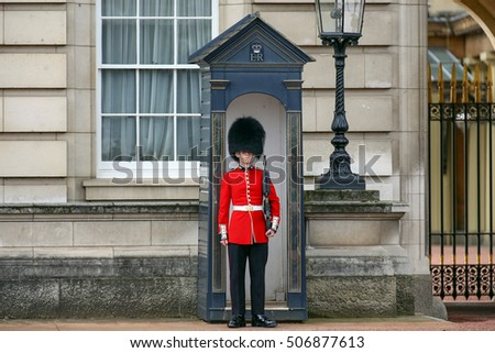London, England, UK - October 12, 2013: The Queen's Guard on duty at Buckingham Palace, the official residence of the Queen of England
