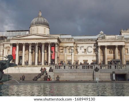 LONDON, ENGLAND, UK - OCTOBER 23: Tourist visiting the world famous Trafalgar Square on October 23, 2013 in London, England, UK - stock photo