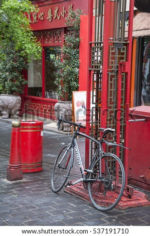 LONDON, ENGLAND, UNITED KINGDOM - MAY 08, 2014: Bicycle parked in a corner of Chinatown