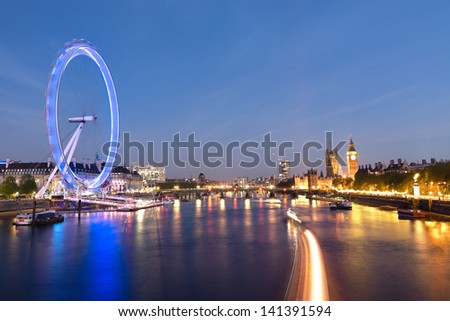 London Eye and Big Ben on the banks of Thames River at twilight - stock photo