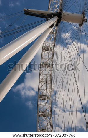 London Eye giant wheel, London, United Kingdom-June 2, 2010: The wheel's mechanical construction consists of an A-frame, spindle, hub and tensioned cables that support the rim