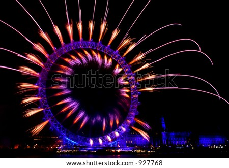 london eye light show and firework during new year eve - stock photo