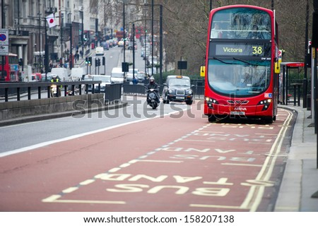 LONDON - FEB 17: Arriva bus on Feb. 17, 2012 in London, UK. Arriva is a multinational public transport company. It has bus, coach, train, tram and waterbus operations in 12 countries across Europe. - stock photo