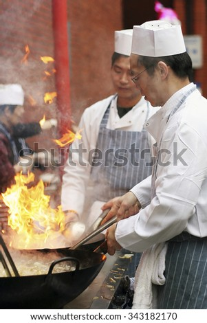 LONDON - FEB 18 : Chinese chefs working at Chinese New Year celebrations in London's Chinatown on Feb18, 2007, London, UK. Various traditional performance attract thousands of people to the street. - stock photo