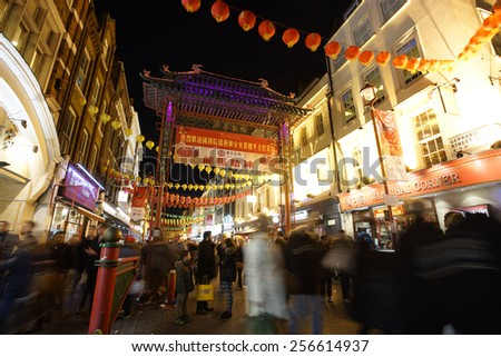 LONDON - FEB 21 :  Night view of London Chinatown, Chinese New Year Eve, established in 1880 th of Chinese sailors and traders, in Soho. a major touristic attraction on Feb 21, 2015, London, UK.