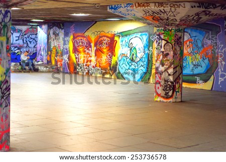 LONDON - FEB 14: South Bank pictured on February 14th, 2015, in London, UK. The south bank area hosts the Hayward Gallery iconic brutalist architecture, and is famous for its street art. - stock photo