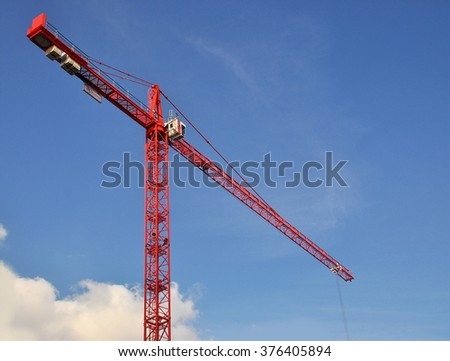 LONDON - FEBRUARY 11, 2016. A red building construction crane on a redevelopment site at Hammersmith, west London, UK. - stock photo