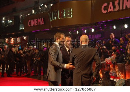 LONDON -  FEBRUARY 7:  Actor Bruce Willis and Sebastian Koch and Jai Courtney are posing on the Red Carpet Premiere of A Good Day To Die Hard in London, UK on Thursday,  February 7, 2013.