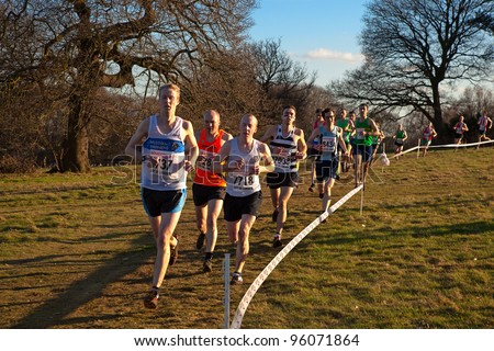 LONDON - FEBRUARY 25: Runners compete in the United Kingdom National Cross Country Championships on Parliament Hill, Hampstead Heath February 25, 2012 in London, England.