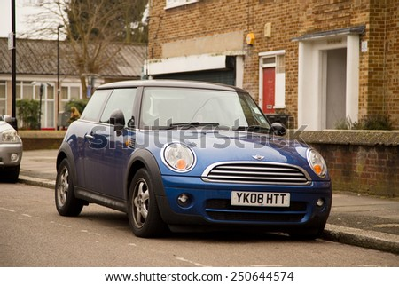LONDON - FEBRUARY 7TH: A Mini on February the 7th, 2015, in London, England, UK. The Mini is a small economy car. - stock photo