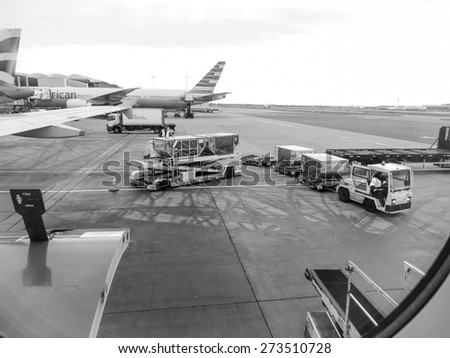 LONDON HEATHROW, CIRCA DECEMBER 2014: view from a plane just landed at the airport, in black and white - stock photo