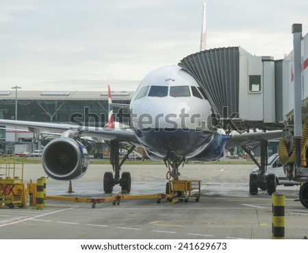 LONDON HEATHROW, UK - CIRCA DECEMBER 2014: An aircraft of the British Airways parked at the airport