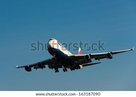 LONDON, HEATHROW, UK - NOV 16: A British Airways  Boeing 747 aircraft approaching Heathrow airport on Nov 16, 2013 in London, UK  ,British Airways is one of the oldest airlines - stock photo