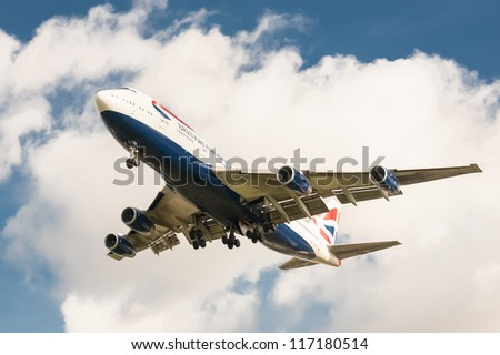 LONDON, HEATHROW, UK - OCTOBER 30:  After skirting Hurricane Sandy during its trans-atlantic flight, a British Airways Boeing 747 lands at London Heathrow International Airport, UK on October 30, 2012 - stock photo