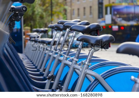 London Hire Bikes - Stock Image. A row of hire bikes lined up in a docking bay in London. Aiming to reduce traffic across the city and introduce an environmentally friendly form of transport. - stock photo