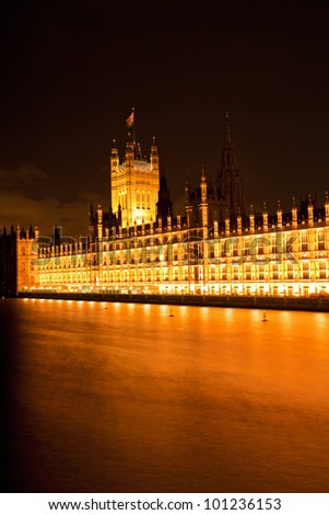 London House of Parliament along River Thames at night England UK