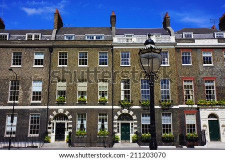London Houses and Streetlight - stock photo