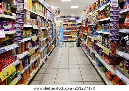 LONDON - JAN 29: A view of an aisle in a Tesco store on Jan 29, 2015 in London, UK. Britain's Tesco is the world's third largest supermarket retailer after America's Walmart and France's Carrefour. - stock photo