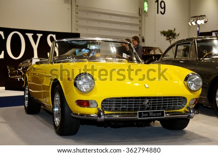 LONDON - JANUARY 10: A vintage Ferrari convertible sports car is put on public display at the inaugural London Classic Car Show event held at the Excel arena on January 10, 2015 in London