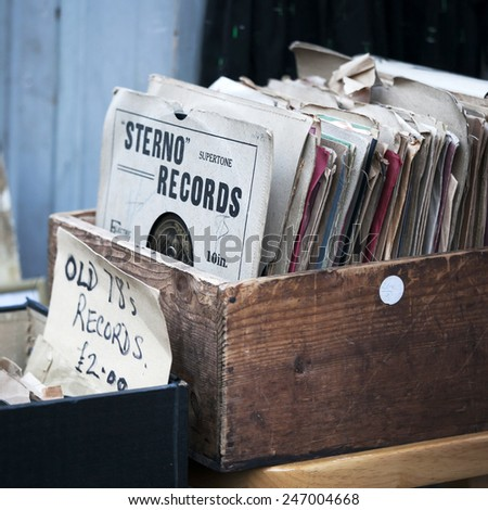 London - January 17, 2015. Flea market window shop with old-fashioned goods displayed in London city, UK, on 13 June 2014. Retro styled image of boxes with vinyl turntable records on a flee market - stock photo